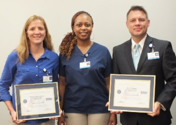 Paul Trumbull, P.T., MBA and Wendy Alberson, P.T. receiving the Patriot Award